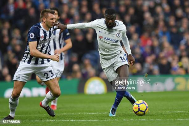 Tiemoue Bakayoko of Chelsea battles with Gareth McAuley of West Bromwich Albion during the Premier League match between West Bromwich Albion and...