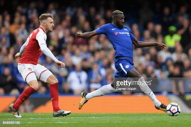 Tiemoue Bakayoko of Chelsea gets control of the ball while under pressure from Aaron Ramsey of Arsenal during the Premier League match between...