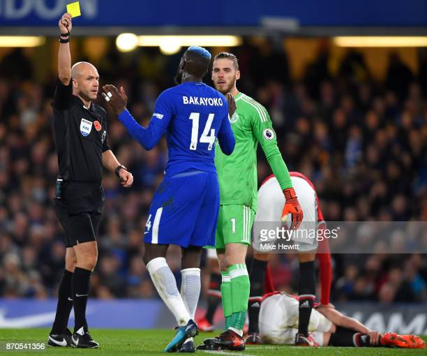 Tiemoue Bakayoko of Chelsea is shown a yellow card by referee Anthony Taylor during the Premier League match between Chelsea and Manchester United at...