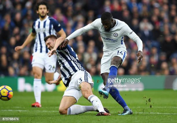 Tiemoue Bakayoko of Chelsea shoots under pressure from Gareth McAuley of West Bromwich Albion during the Premier League match between West Bromwich...