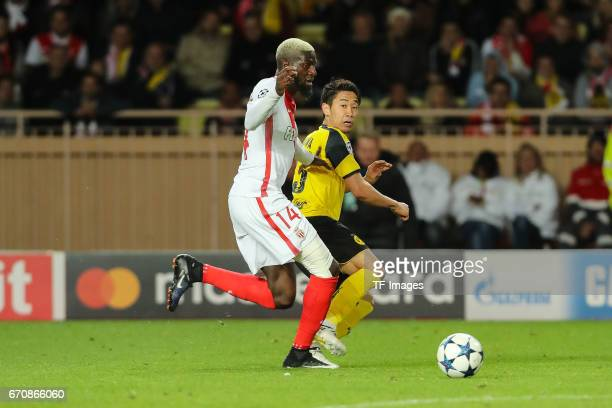 Tiemoue Bakayoko of Monaco and Shinji Kagawa of Dortmund battle for the ball during the UEFA Champions League quarter final second leg match between...