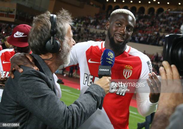 Tiemoue Bakayoko of Monaco is interviewed by Laurent Paganelli during the French League 1 Championship title celebration following the French Ligue 1...