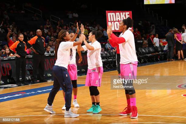 Tierra RuffinPratt and Kristi Toliver of the Washington Mystics shake hands before the game against the Phoenix Mercury on August 18 2017 at the...