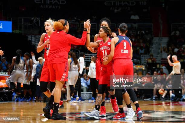 Tierra RuffinPratt and Tianna Hawkins of the Washington Mystics high five each other during the game against the Minnesota Lynx in Game Three of the...