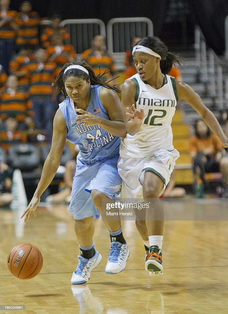 Tierra Ruffin-Pratt of North Carolina drives down court against Kyrstal Saunders of Miami during a women's college basketball game at the BankUnited Center in Coral Gables, Florida, Sunday, January 27, 2013. The North Carolina Tar Heels defeated the Miami Hurricanes, 64-62.