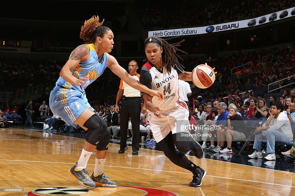 Tierra Ruffin-Pratt #14 of the Washington Mystics drives against Courtney Clements #0 of the Chicago Sky at the Verizon Center on August 13, 2014 in Washington, DC.