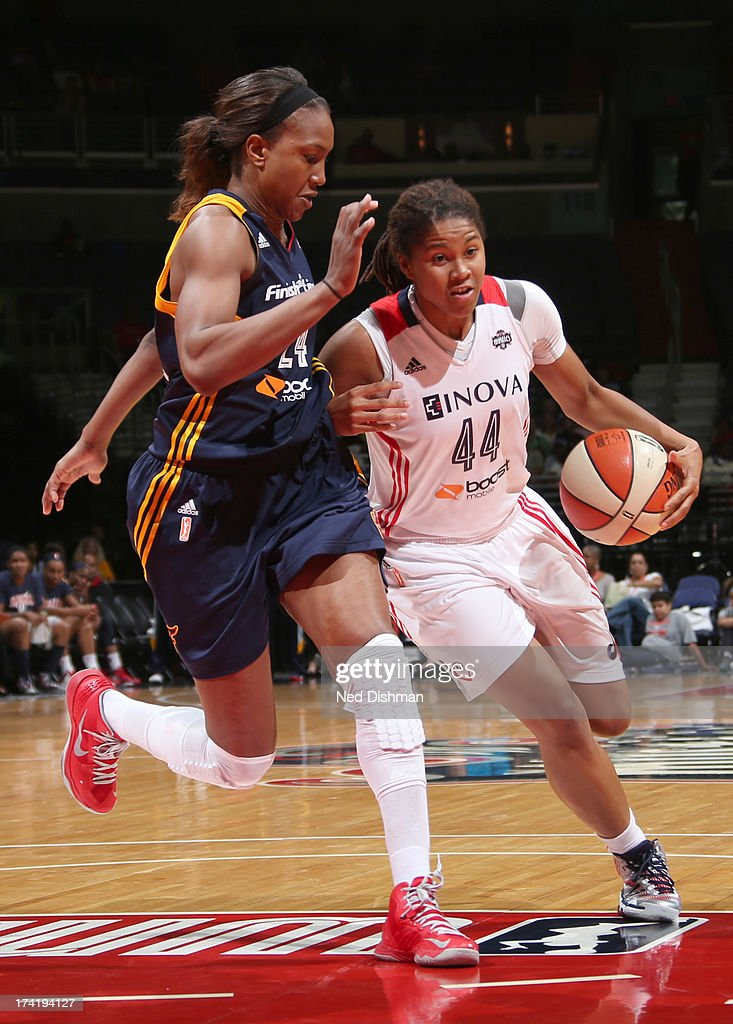 Tierra Ruffin-Pratt #44 of the Washington Mystics drives against <a gi-track='captionPersonalityLinkClicked' href=/galleries/search?phrase=Tamika+Catchings&family=editorial&specificpeople=202220 ng-click='$event.stopPropagation()'>Tamika Catchings</a> #24 of the Indiana Fever at the Verizon Center on July 21, 2013 in Washington, DC.