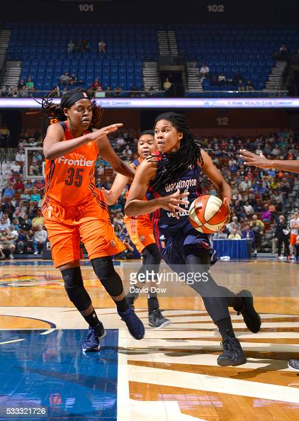 Tierra RuffinPratt of the Washington Mystics drives the basketball against Kelly Faris of the Connecticut on May 21 2016 at the Mohegan Sun Arena in...