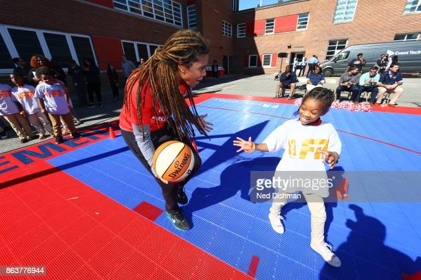 Tierra RuffinPratt of the Washington Mystics participates in a clinic at Hendley Elementary school during a court dedication and WNBA Fit Clinic on...