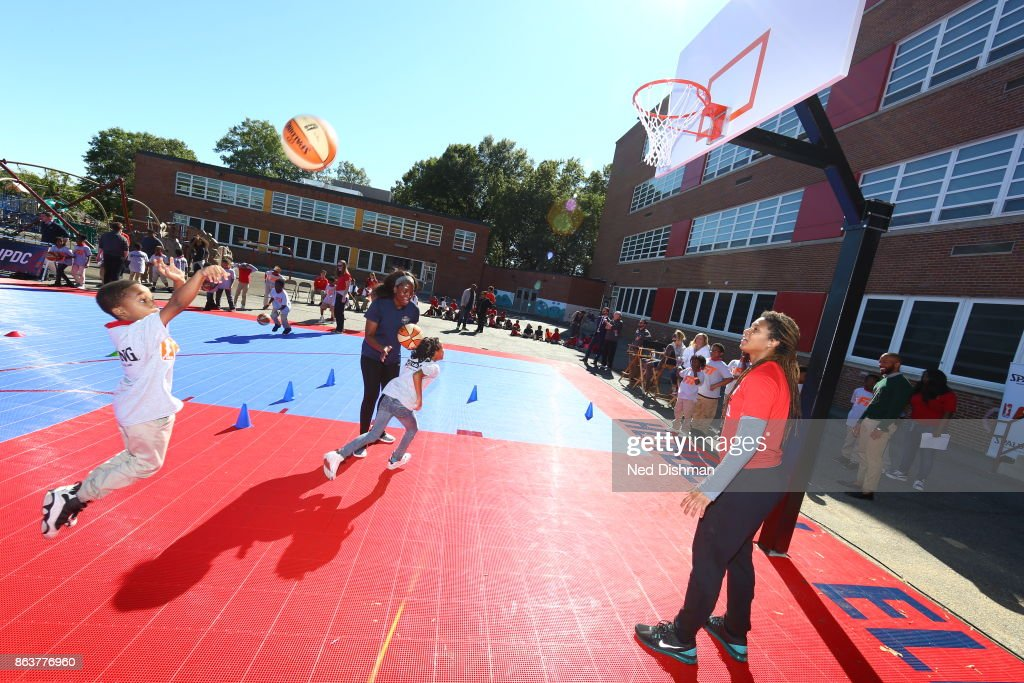 Tierra Ruffin-Pratt of the Washington Mystics participates in a clinic at Hendley Elementary school during a court dedication and WNBA Fit Clinic on October 17, 2017 at Hendley Elementary school in Washington, DC.