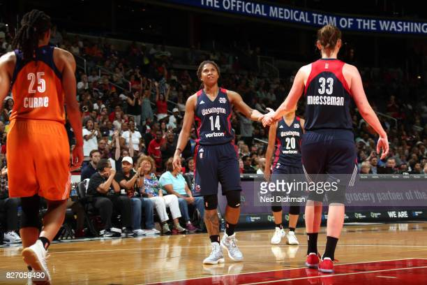 Tierra RuffinPratt of the Washington Mystics shake hands with teammates during the game against the Phoenix Mercury on August 6 2017 at the Verizon...