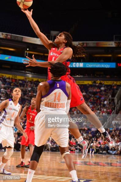 Tierra RuffinPratt of the Washington Mystics shoots against Alexis Hornbuckle of the Phoenix Mercury on June 21 2013 at US Airways Center in Phoenix...