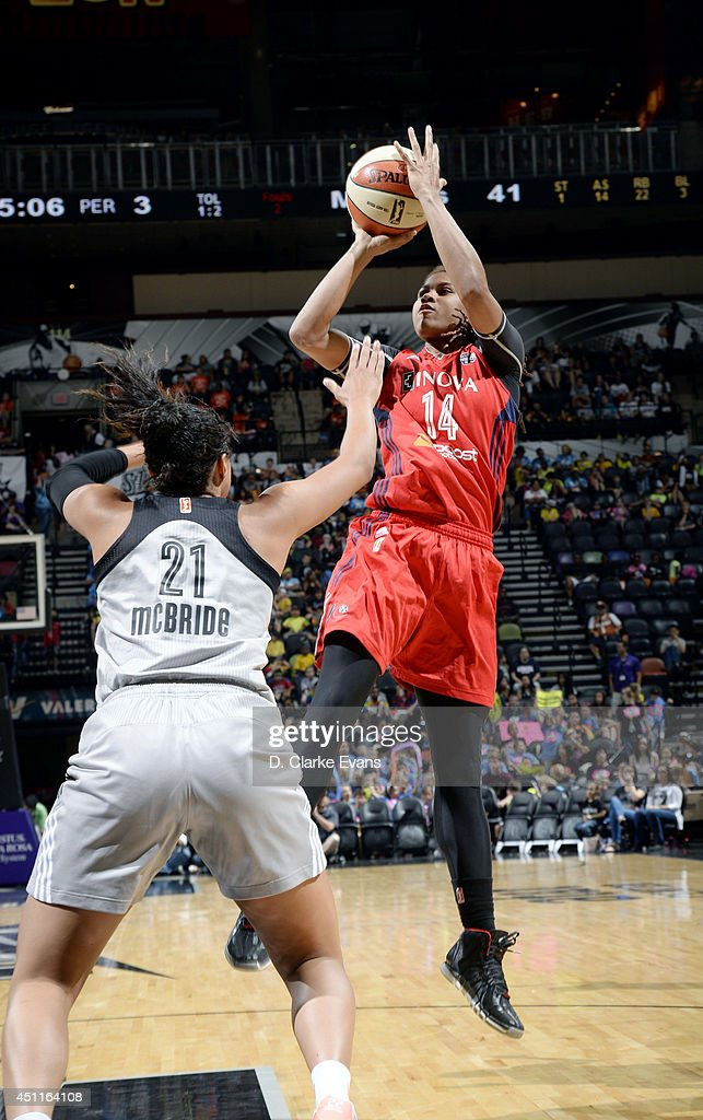 Tierra Ruffin-Pratt #14 of the Washington Mystics shoots against <a gi-track='captionPersonalityLinkClicked' href=/galleries/search?phrase=Kayla+McBride&family=editorial&specificpeople=9017392 ng-click='$event.stopPropagation()'>Kayla McBride</a> #21 of the San Antonio Stars at the AT&T Center on June 24, 2014 in San Antonio, Texas.