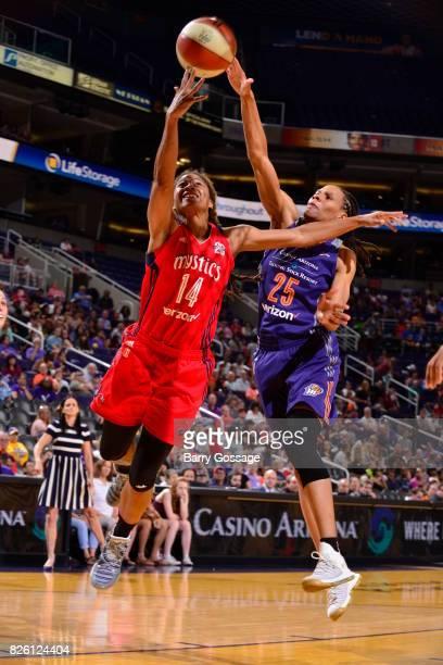 Tierra RuffinPratt of the Washington Mystics shoots the ball against Monique Currie of the Phoenix Mercury on July 5 2017 at Talking Stick Resort...