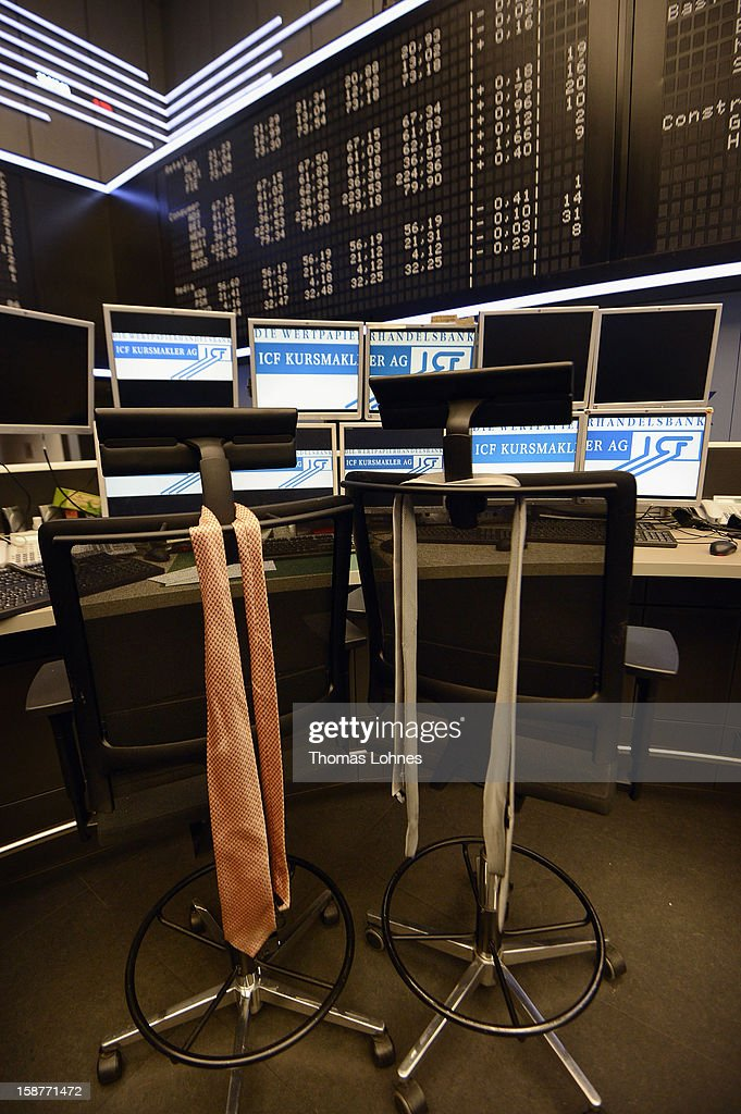 Ties hang from chairs on the last day of trading for 2012 at the Frankfurt Stock Exchange on December 28, 2012 in Frankfurt, Germany. The DAX index of Germany's largest corporations finished the year at over 7,500, which represents a strong increase for the year. At the same time one year ago the index stood at just under 6,000.
