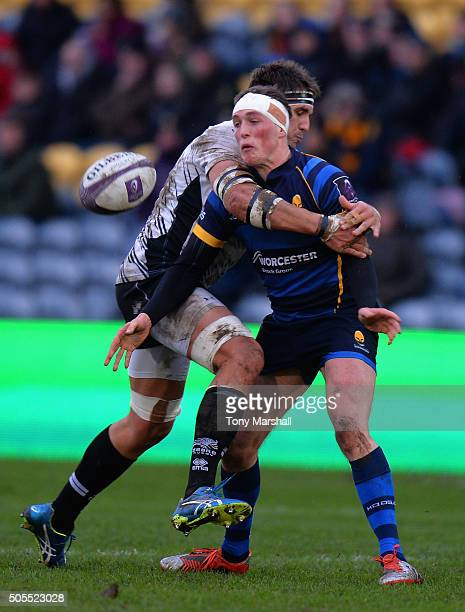 Tiff Eden of Worcester Warriors is tackled by Dries van Schalkwyk of Zebre Rugby during the European Rugby Challenge Cup match between Worcester...