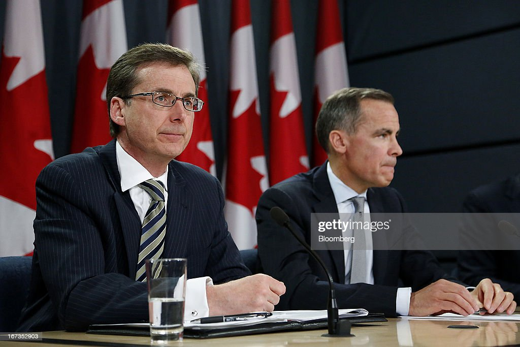 Tiff Macklem, senior deputy governor of the Bank of Canada, left, and <a gi-track='captionPersonalityLinkClicked' href=/galleries/search?phrase=Mark+Carney&family=editorial&specificpeople=3028157 ng-click='$event.stopPropagation()'>Mark Carney</a>, governor of the Bank of Canada, attend a press conference in Ottawa, Ontario, Canada, on Wednesday, April 17, 2013. The Canadian dollar weakened to the lowest level in a month versus its U.S. counterpart after the Bank of Canada reduced its growth forecast for 2013 and said economic slack will persist for more than two years. Photographer: Patrick Doyle/Bloomberg via Getty Images