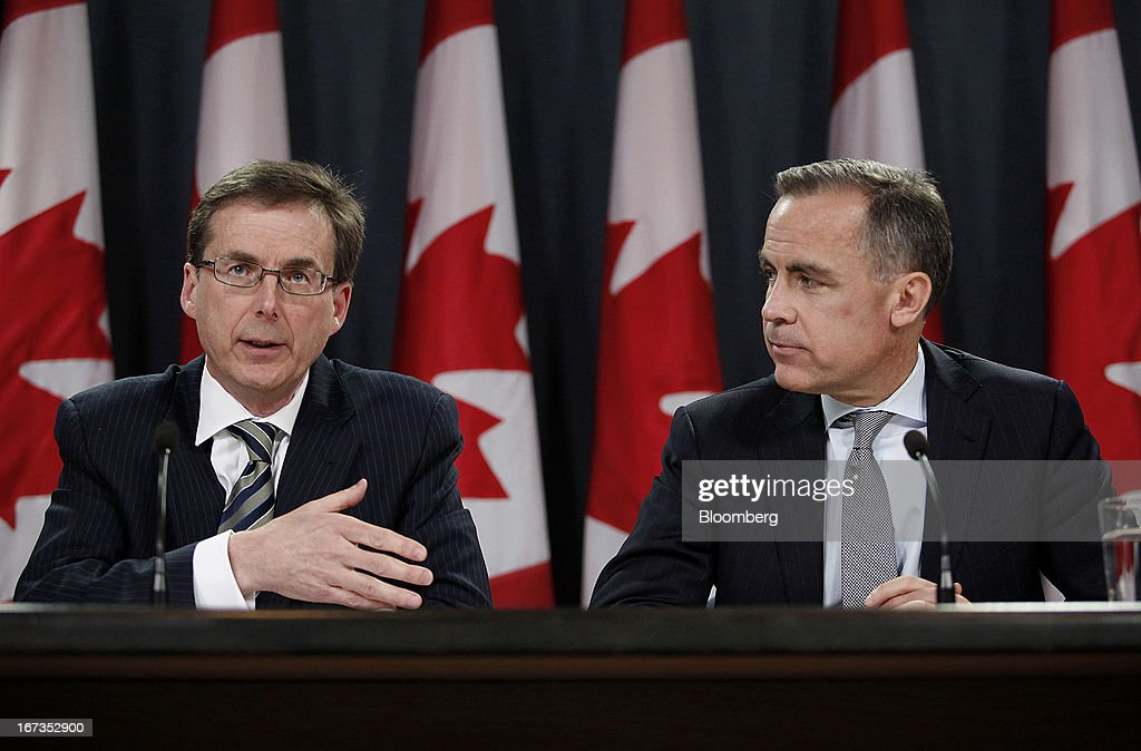 Tiff Macklem, senior deputy governor of the Bank of Canada, left, speaks while <a gi-track='captionPersonalityLinkClicked' href=/galleries/search?phrase=Mark+Carney&family=editorial&specificpeople=3028157 ng-click='$event.stopPropagation()'>Mark Carney</a>, governor of the Bank of Canada, listens during a press conference in Ottawa, Ontario, Canada, on Wednesday, April 17, 2013. The Canadian dollar weakened to the lowest level in a month versus its U.S. counterpart after the Bank of Canada reduced its growth forecast for 2013 and said economic slack will persist for more than two years. Photographer: Patrick Doyle/Bloomberg via Getty Images