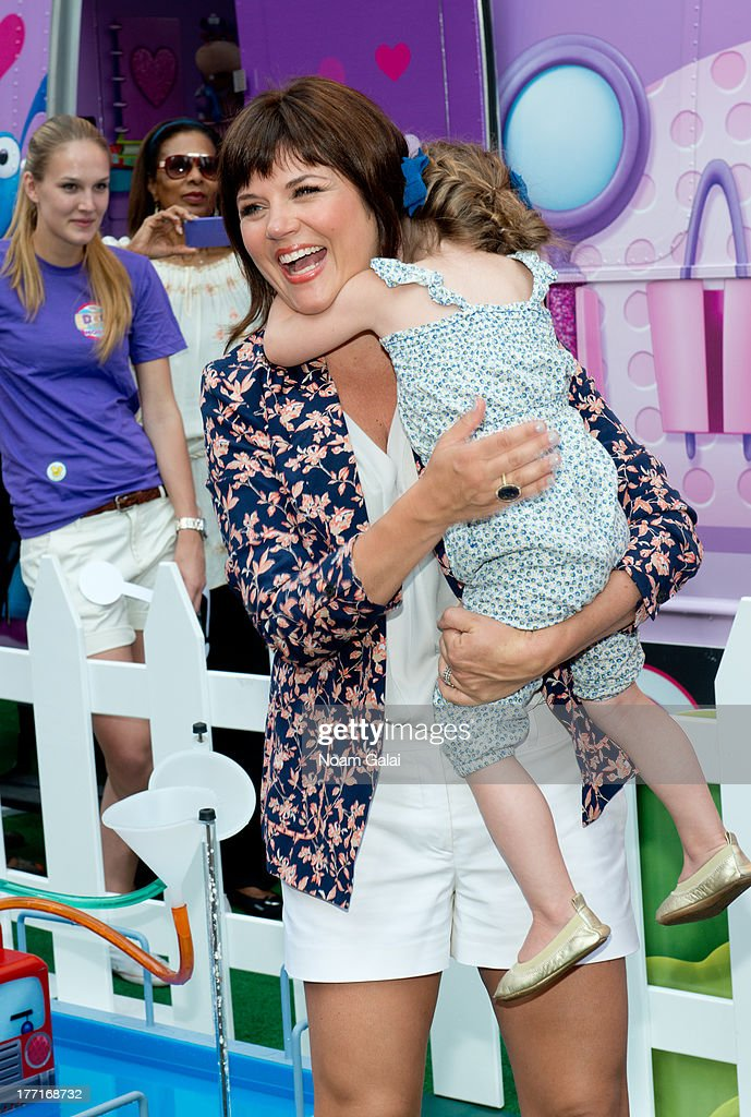 <a gi-track='captionPersonalityLinkClicked' href=/galleries/search?phrase=Tiffani+Thiessen&family=editorial&specificpeople=221649 ng-click='$event.stopPropagation()'>Tiffani Thiessen</a> and daughter Harper Smith attend the Doc Mobile Tour at the Disney Store on August 21, 2013 in New York City.