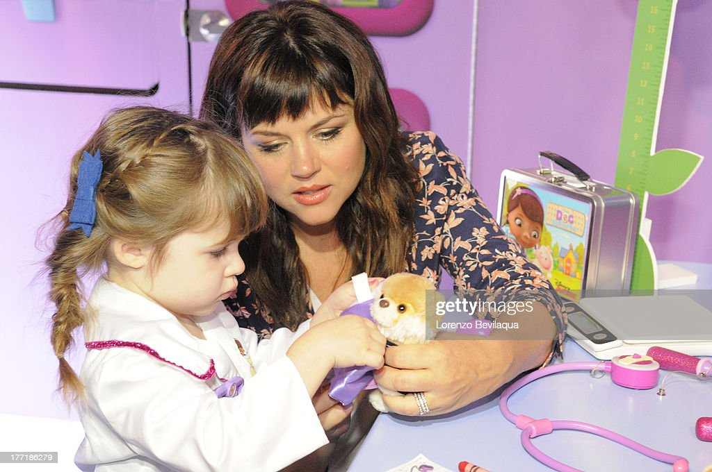 DOC MCSTUFFINS - Tiffani Thiessen and daughter Harper were on hand when The Doc Mobile, an interactive, health-focused tour based on Disney Junior's acclaimed animated series 'Doc McStuffins' made a stop in front of New York's Times Square Disney Store on Wednesday, August 21. The Doc Mobile is currently on a multi-city tour bringing fun and empowering experiences relating to health and nutrition to young kids and families. HARPER