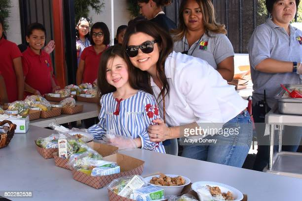 Tiffani Thiessen and daughter her Harper Smith volunteer at Feeding America's Summer Hunger Awareness event At Para Los Ninos in Los Angeles on June...