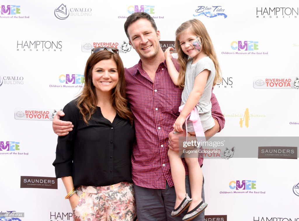 Tiffani Thiessen Brady Smith and Harper Renn Smith attend the CMEE 6th Annual Family Fair at Children's Museum of the East End on July 19 2014 in...