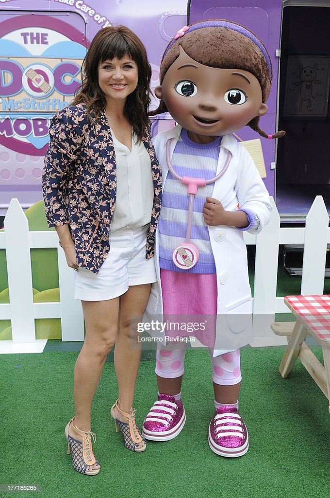 DOC MCSTUFFINS - <a gi-track='captionPersonalityLinkClicked' href=/galleries/search?phrase=Tiffani+Thiessen&family=editorial&specificpeople=221649 ng-click='$event.stopPropagation()'>Tiffani Thiessen</a> brought along her daughter Harper to The Doc Mobile, an interactive, health-focused tour based on Disney Junior's acclaimed animated series 'Doc McStuffins' made a stop in front of New York's Times Square Disney Store on Wednesday, August 21. The Doc Mobile is currently on a multi-city tour bringing fun and empowering experiences relating to health and nutrition to young kids and families. MCSTUFFINS
