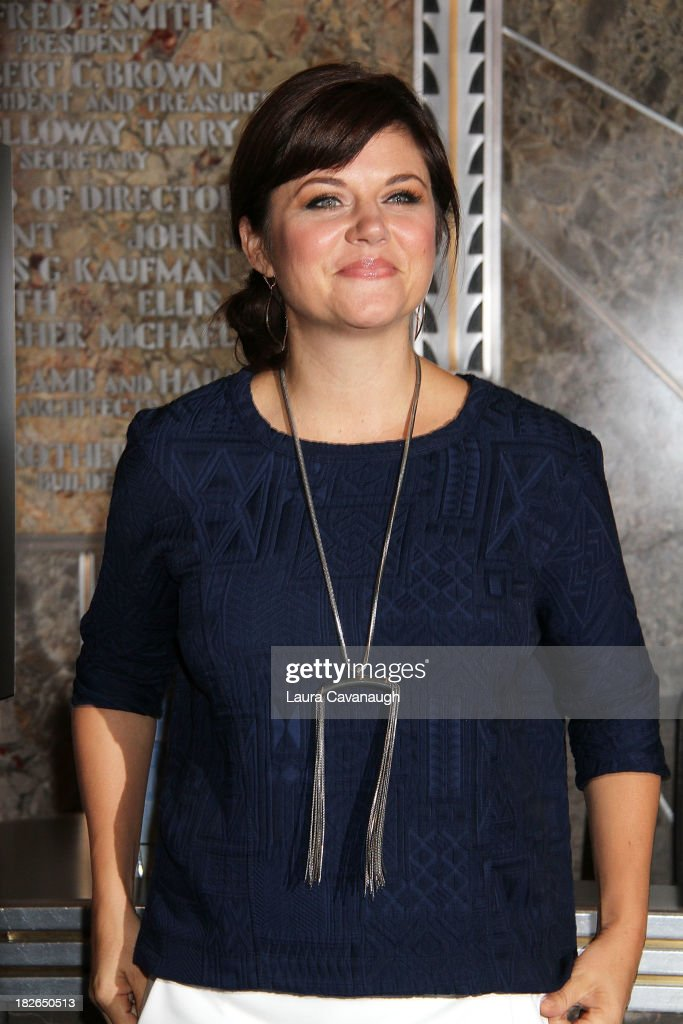 <a gi-track='captionPersonalityLinkClicked' href=/galleries/search?phrase=Tiffani+Thiessen&family=editorial&specificpeople=221649 ng-click='$event.stopPropagation()'>Tiffani Thiessen</a> lights the Empire State building 'Jumpstart Red' to celebrate Jumpstart's Read For The Record campaign on October 2, 2013 in New York City.