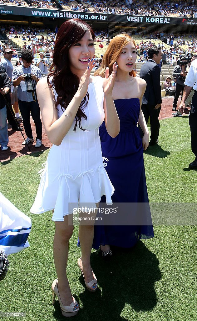 Tiffany (L) and Taeyeon of Korean Pop group Girls Generation take part during Korea Day ceremonies before the game between the Cincinnati Reds and the Los Angeles Dodgers at Dodger Stadium on July 28, 2013 in Los Angeles, California.