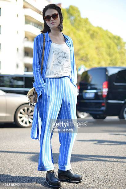 Tiffany Chenet poses wearing a Closed suit before the Celine show at the Tennis Club de Paris during Paris Fashion Week SS16 on October 4 2015 in...