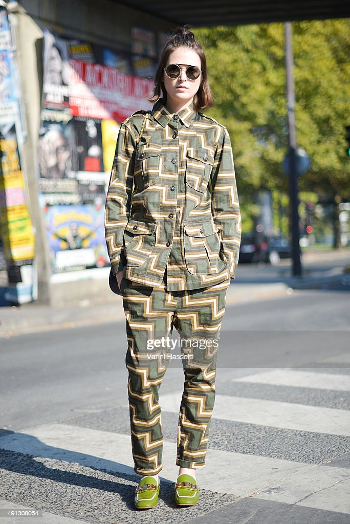 Tiffany Chenet poses wearing a Closed suit Chloe bag and Prada shoes after the Kenzo show at the Paris Event Center during Paris Fashion Week SS16 on...