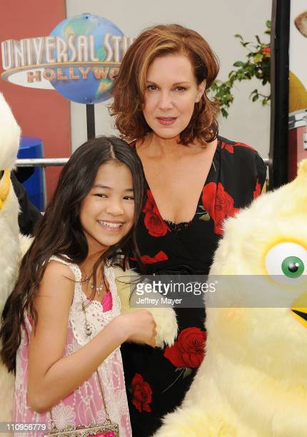 Tiffany Espensen and Elizabeth Perkins arrive at the Los Angeles premiere of 'Hop' at Universal Studios Hollywood on March 27 2011 in Universal City...