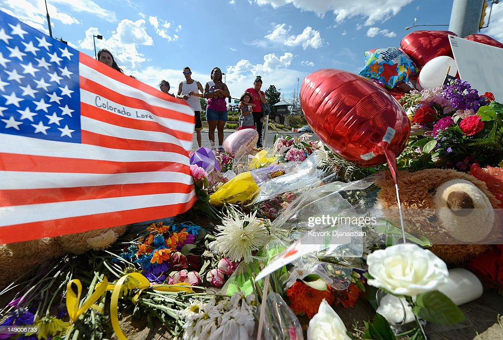 Tiffany Garcia and her sixyearold daughter Angelina Garcia cry as they look at a makeshift memorial across the street from the Century 16 movie...