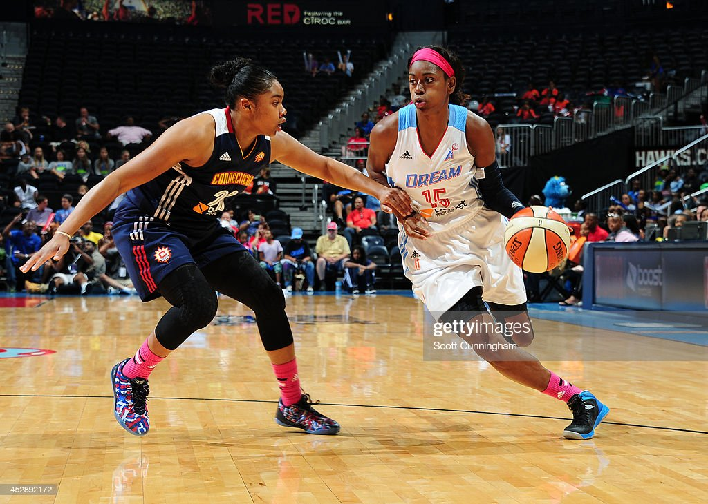 Tiffany Hayes #15 of the Atlanta Dream drives against Alex Bentley #20 of the Connecticut Sun on July 29, 2014 at Philips Arena in Atlanta, Georgia.