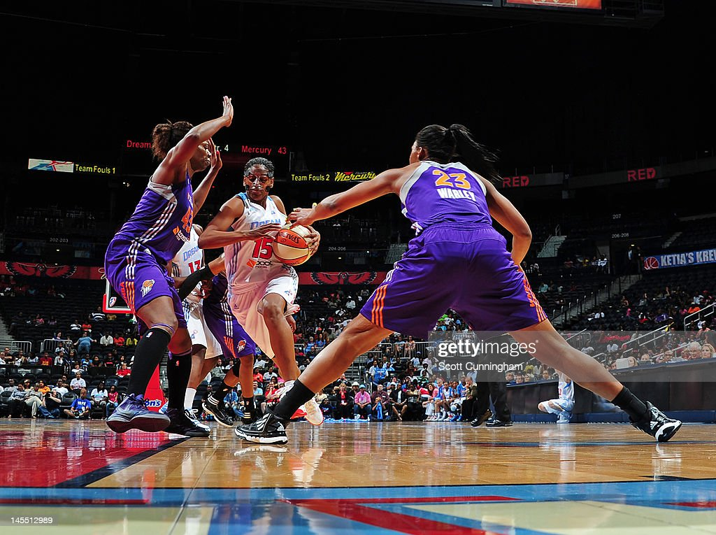 Tiffany Hayes of the Atlanta Dream drives against Avery Warley and Nakia Sanford of the Phoenix Mercury at Philips Arena on May 31 2012 in Atlanta...