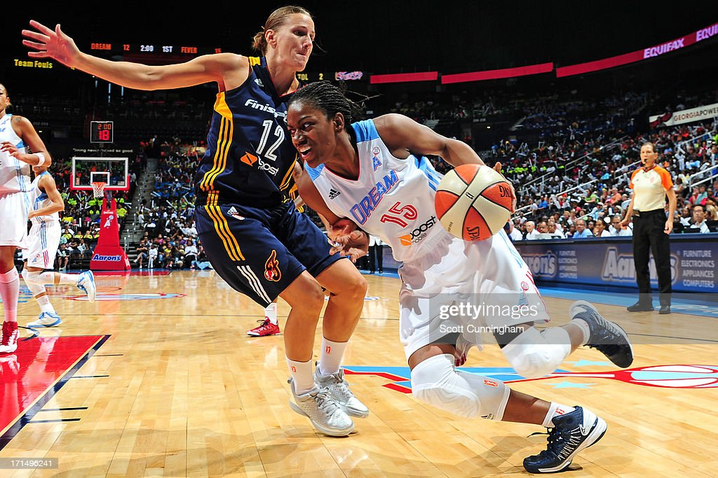 Tiffany Hayes #15 of the Atlanta Dream drives against Erin Thorn #12 of the Indiana Fever at Philips Arena on June 25, 2013 in Atlanta, Georgia.