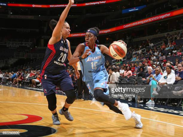 Tiffany Hayes of the Atlanta Dream drives to the basket against Kristi Toliver of the Washington Mystics on June 4 2017 at Verizon Center in...