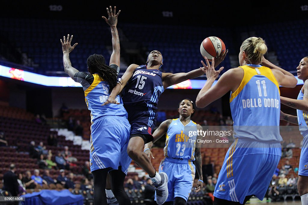 Tiffany Hayes #15 of the Atlanta Dream drives to the basket past Jessica Breland #51, (left) and Elena Delle Donne #11, (right) of the Chicago Sky during the Atlanta Dream Vs Chicago Sky preseason WNBA game at Mohegan Sun Arena on May 05, 2016 in Uncasville.