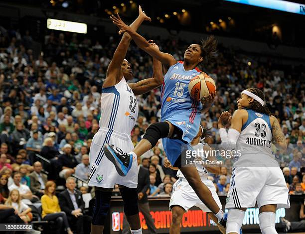 Tiffany Hayes of the Atlanta Dream shoots agasint Rebekkah Brunson and Seimone Augustus of the Minnesota Lynx during the second quarter of Game Two...