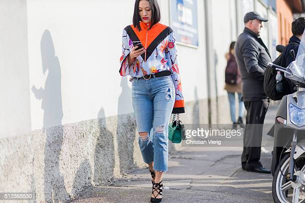 Tiffany Hsu wearing Fendi jacket and bag and light blue ripped denim jeans seen outside Emilio Pucci during Milan Fashion Week Fall/Winter 2016/17 on...