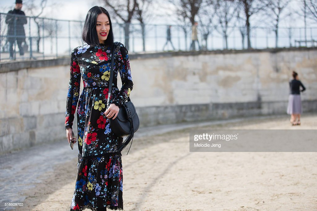 Tiffany Hsu wears a black Erdem floral dress at the Valentino show at the Tuileries on March 07, 2016 in Paris, France.