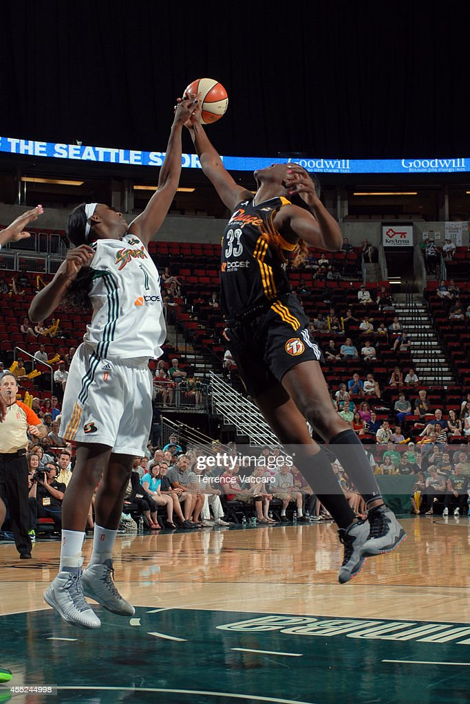 Tiffany Jackson-Jones #33 of the Tulsa Shock attempts to rebound the ball against <a gi-track='captionPersonalityLinkClicked' href=/galleries/search?phrase=Crystal+Langhorne&family=editorial&specificpeople=700514 ng-click='$event.stopPropagation()'>Crystal Langhorne</a> #1 of the Seattle Storm during the game on August 10,2014 at Key Arena in Seattle, Washington.