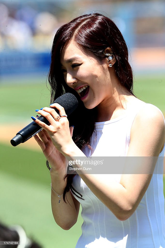 Tiffany of Korean Pop group Girls Generation sings the US national anthen during Korea Day ceremonies before the game between the Cincinnati Reds and the Los Angeles Dodgers at Dodger Stadium on July 28, 2013 in Los Angeles, California.