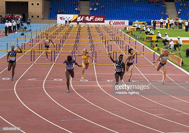 Tiffany Porter of Europe Rikenette Steenkamp of South Africa Dawn Harper Nelson of USA Ayako Kimura of Japan and Cindy Roleder of Germany compete...