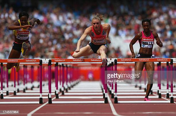 Tiffany Porter of Great Britain Sally Pearson of Australia and Kellie Wells of the United States compete in the Women's 100m Hurdles during day two...