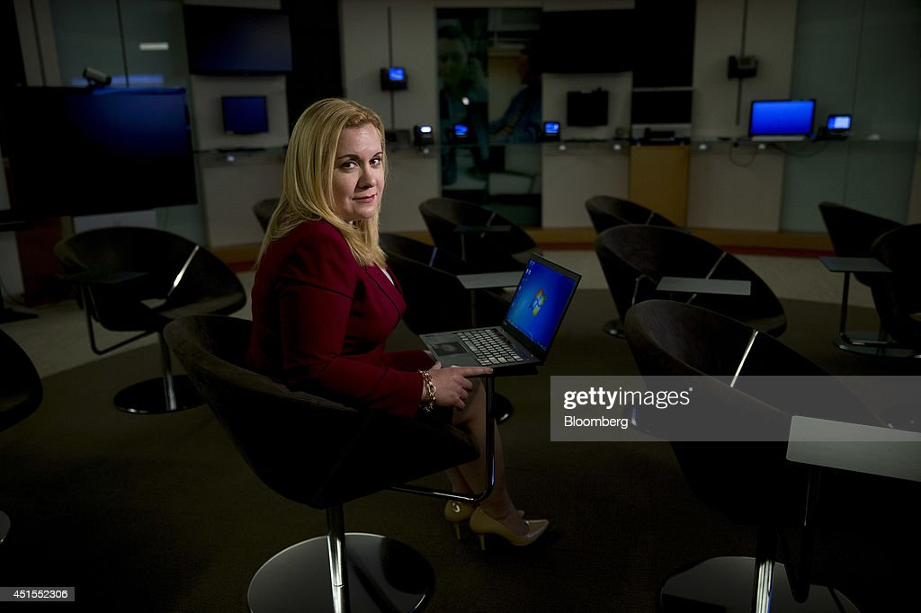 Tiffany Rad, manager of threat research for ThreatGrid Inc., sits for a photograph at a Cisco Systems Inc. office in Herndon, Virginia, U.S., on Friday, June 27, 2014. Rad is a 'white hat,' a hacker who specializes in looking for security holes so that they can be fixed. The attorney turned her computer-hacking hobby into a career in 2008, when she submitted a research proposal to an underground security conference in New York. Photographer: Andrew Harrer/Bloomberg via Getty Images