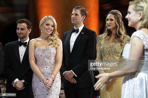 Tiffany Trump and her guest Ross Mechanic and Eric Trump and his wife Lara Yunaska watch as US President Donald Trump cuts a cake during the...
