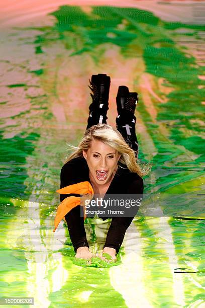 Tiffiny Hall slides down slime during the Nickelodeon Slimefest 2012 evening show at Hordern Pavilion on September 15 2012 in Sydney Australia