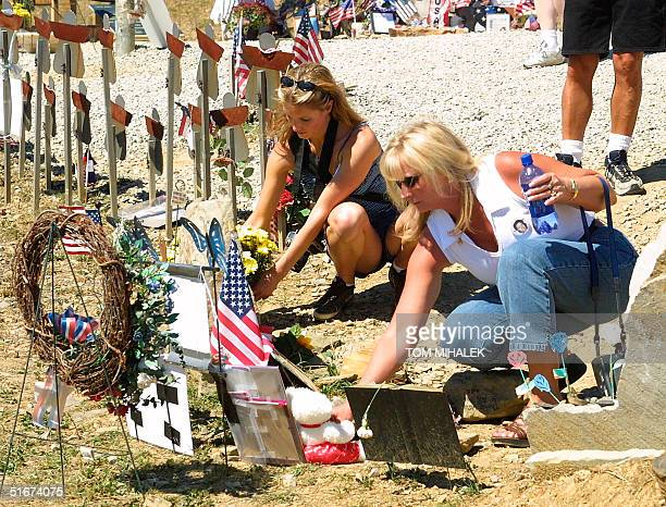 Tiffney Miller and her mother Cathy Stefani of San Jose CA place flowers and a teddy bear at a memorial for their sister and daughter Nicole Miller...