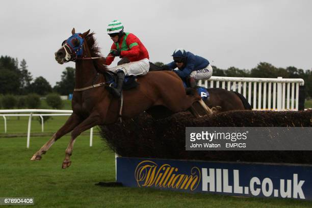 Tifoso ridden by Brian Hughes jumps the fence during the Betfair iPhone Android App Handicap Chase